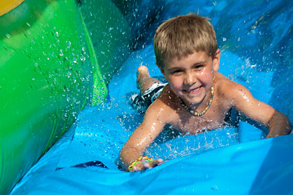 Sam goes down water slide