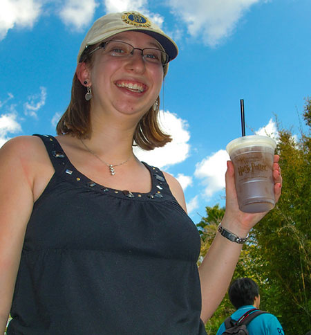 Rachel enjoys a butterbeer at the Wizarding World of Harry Potter