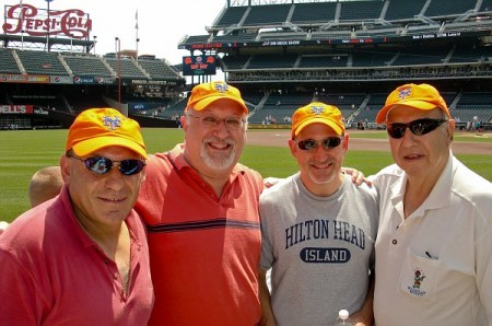 Dad with his three boys at a Mets game in 2010.