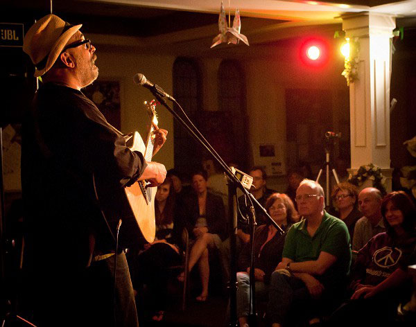 Vance Gilbert performs at the Rose Garden Coffeehouse in May 2011 ~ Photo by Stephen Ide
