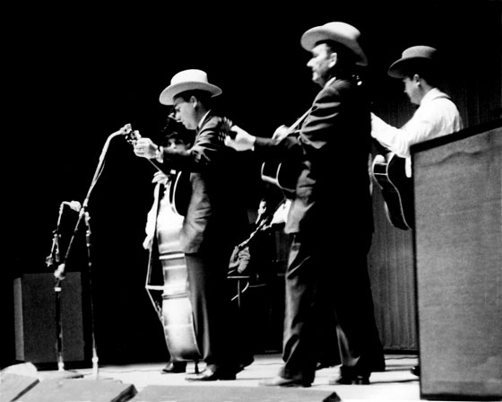 "Earl Scruggs at the microphone, with Lester Flatt. This photo, from 1964, was shot by North Attleboro resident Samuel ""Mac"" McLanahan, in Baltimore."