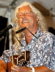 Arlo Guthrie performs at the Falcon Ridge Folk Festival, 2003. Photo by Stephen Ide