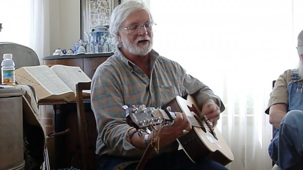 Bill Staines performs at a house concert in Franklin in 2010. Photo by Stephen Ide.