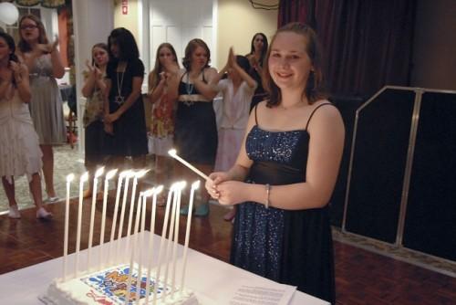 Lauren lights the candles