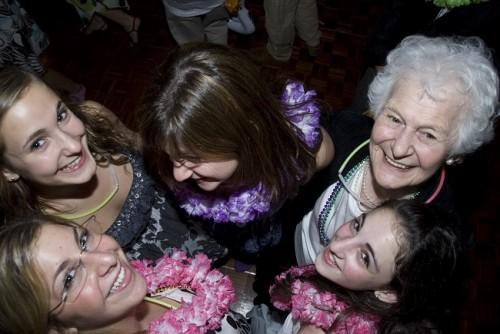Grandma Sally dances with her grandkids