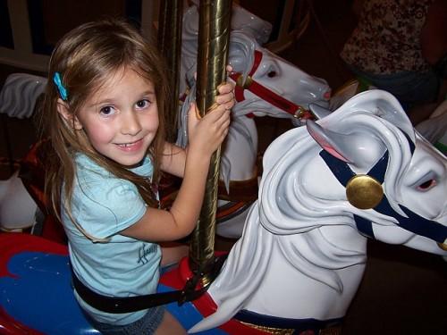 Heidi rides the carousel